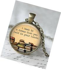 Round 'A book is a dream you can hold in your hands' quote